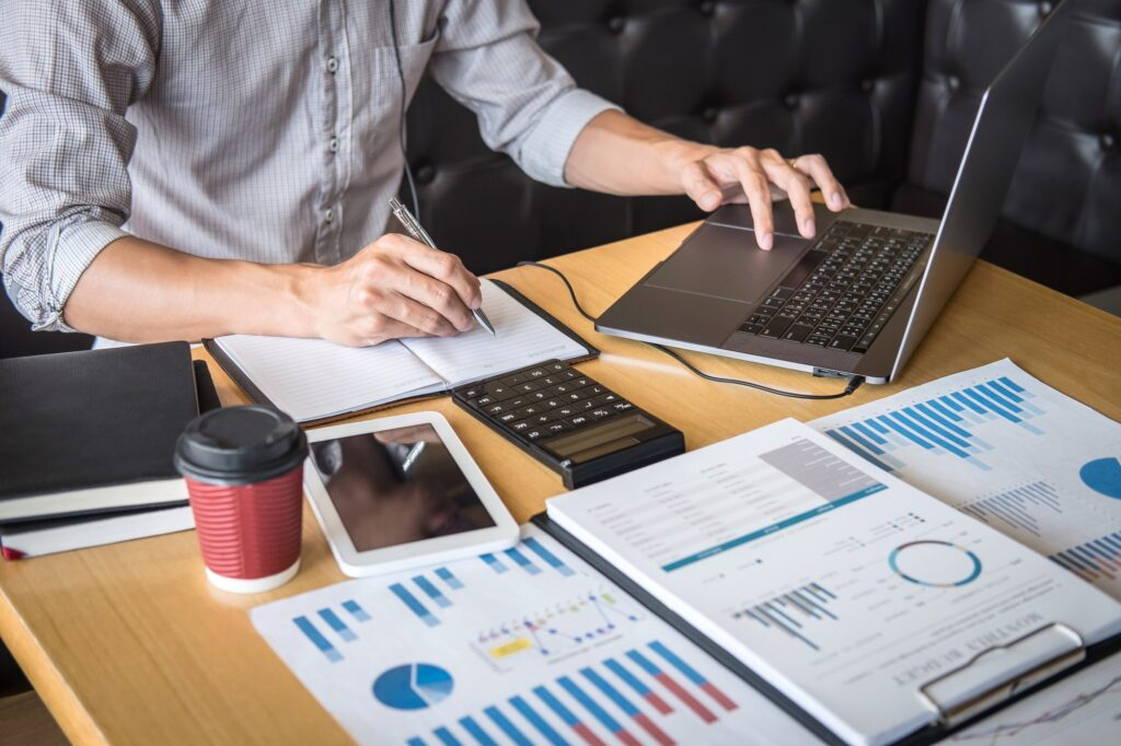 Businessman accountant working audit and calculating expense financial annual financial report